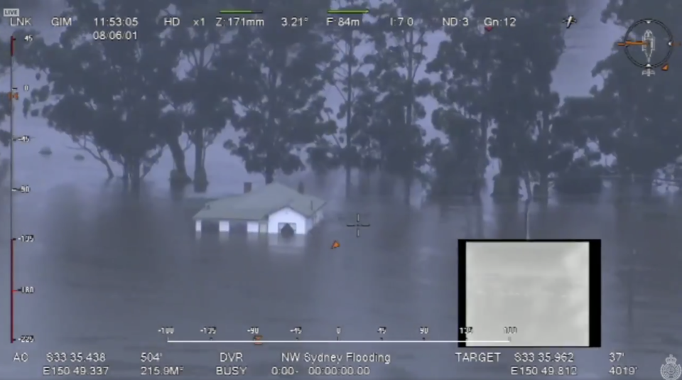 A house in Sydney's northwest covered by floodwaters.