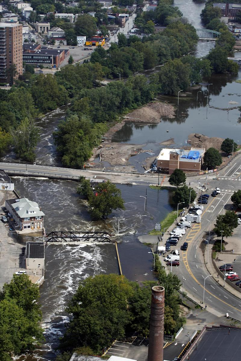 The Passaic River continues to threaten bridges and businesses Thursday, Sept. 1, 2011, in Paterson, N.J., as the effects of Hurricane Irene continue to leave areas of northern New Jersey flooded. Flooding continues to hamper recovery efforts from Hurricane Irene in northern new Jersey while residents can begin seeking aid under a disaster declaration signed by President Barack Obama. (AP Photo/Mel Evans)