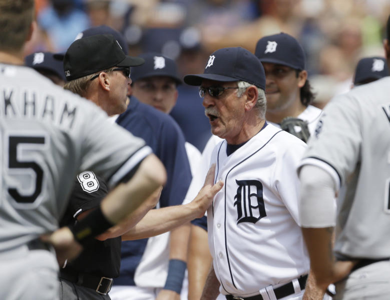 Detroit Tigers manager Jim Leyland is restrained by an umpire after the benches cleared during the sixth inning of a baseball game against the Chicago White Sox in Detroit, Thursday, July 11, 2013. (AP Photo/Carlos Osorio)
