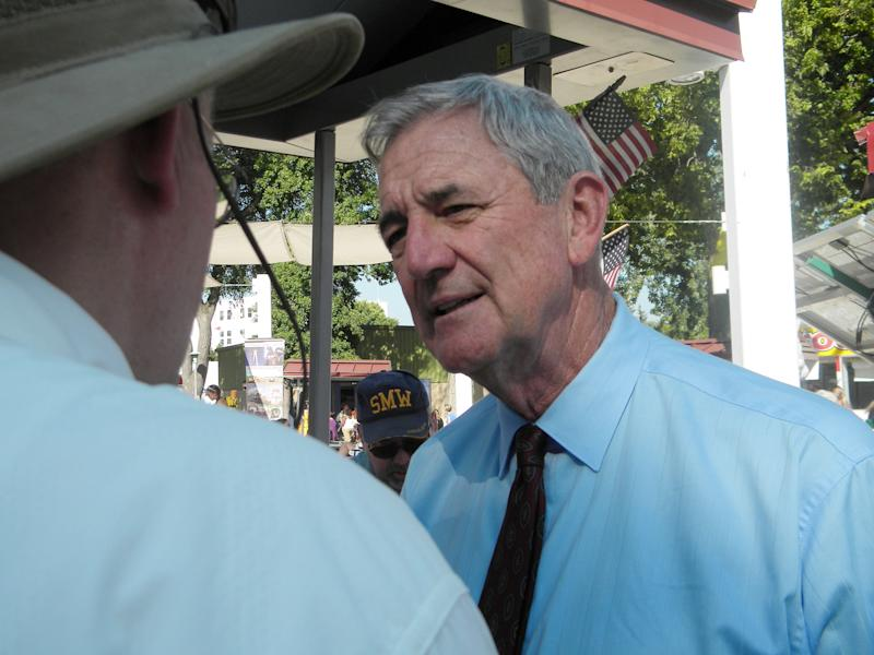 In this Aug. 29, 2012 photo, former congressman Rick Nolan, right, talks with voter Jerry Anderson at the Minnesota State Fair in Falcon Heights, Minn. Nolan, a Democrat, one of several former lawmakers seeking to make comebacks in the upcoming November general election, is running for Minnesota's Eighth Congressional District. (AP Photo/Martiga Lohn)