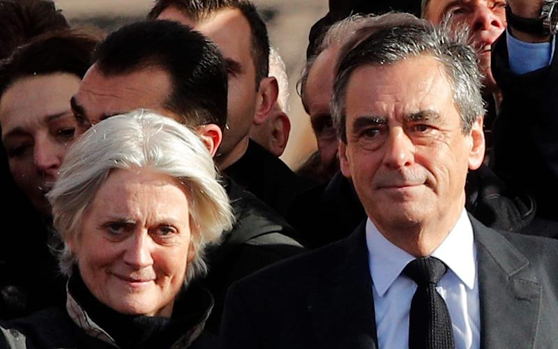 French Republican presidential candidate Francois Fillon and his wife Penelope  - AP