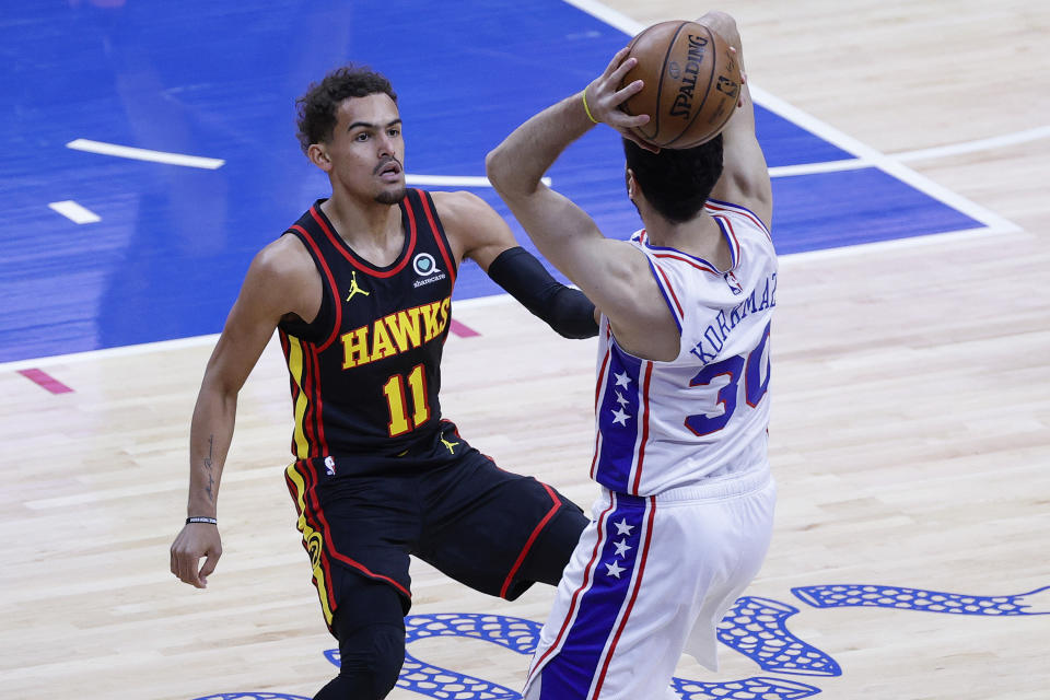 PHILADELPHIA, PENNSYLVANIA - JUNE 20: Trae Young #11 of the Atlanta Hawks guards Furkan Korkmaz #30 of the Philadelphia 76ers during the first quarter during Game Seven of the Eastern Conference Semifinals at Wells Fargo Center on June 20, 2021 in Philadelphia, Pennsylvania. NOTE TO USER: User expressly acknowledges and agrees that, by downloading and or using this photograph, User is consenting to the terms and conditions of the Getty Images License Agreement. (Photo by Tim Nwachukwu/Getty Images)