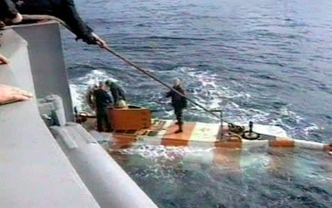 <span>Russia rescue personnel return from a dive in a mini submarine to the Kursk on the sea bed</span> <span>Credit: RU-RTR Russian Television via AP </span>
