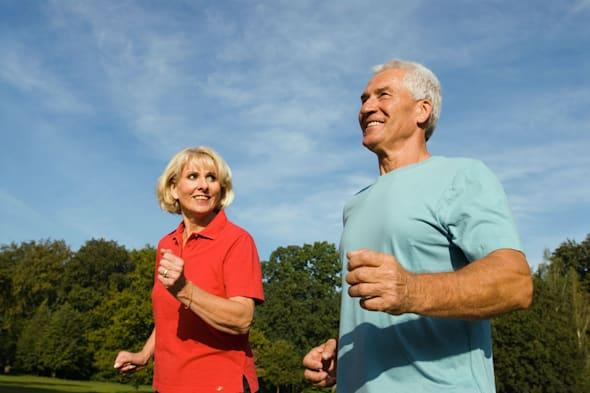 A0KARM close up of mature man and woman jogging