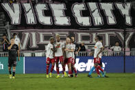 New York Red Bulls players celebrate a goal by forward Fabio Gomez, center, during the second half of an MLS soccer match against Inter Miami, Friday, Sept. 17, 2021, in Fort Lauderdale, Fla. (AP Photo/Rebecca Blackwell)