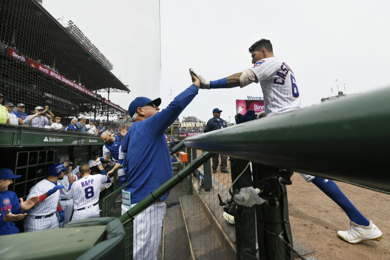 Chicago Cubs' Nicholas Castellanos right, celebrates with manager Joe Maddon left, at the dugout after hitting a two-run home run during the first inning of a baseball game against the Milwaukee Brewers Friday, Aug 30, 2019, in Chicago. (AP Photo/Paul Beaty)