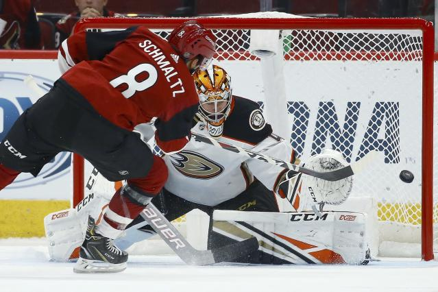 Arizona Coyotes center Nick Schmaltz (8) scores a goal against Anaheim Ducks goaltender Kevin Boyle, right, during the shootout in a preseason NHL hockey game Saturday, Sept. 21, 2019, in Glendale, Ariz. The Coyotes won 4-3. (AP Photo/Ross D. Franklin)