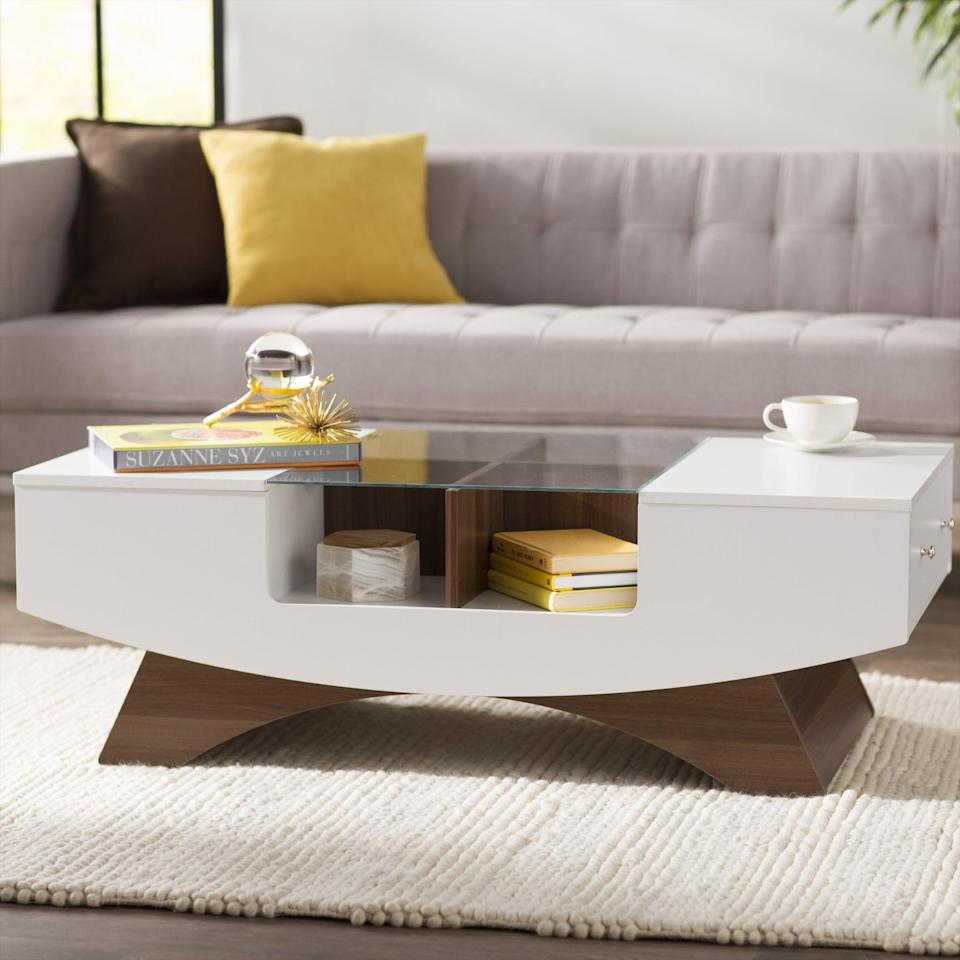 <p>Put decorative pieces in this <span>Madilynn Trestle Coffee Table With Storage</span> ($283).</p>