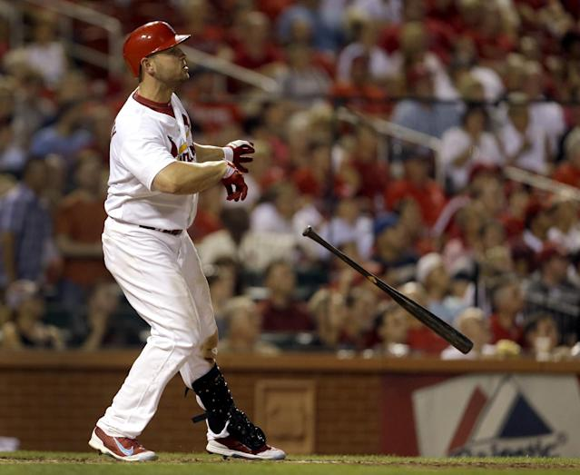 St. Louis Cardinals' Matt Holliday drops his bat as he watches his two-run home run during the sixth inning of a baseball game against the Milwaukee Brewers on Tuesday, Sept. 10, 2013, in St. Louis. (AP Photo/Jeff Roberson)