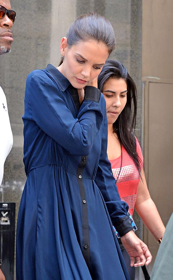 """While Katie seems to be enjoying quality time with Suri, she has also been working. On July 2 — just days after her divorce filing — she surprised many by honoring her commitment to appear as a guest judge on """"Project Runway: All Stars."""" Wearing a blue dress, she filmed the spot at Parsons The New School for Design in Union Square. Katie seems to be focusing more on her fashion line, Holmes & Yang, which she collaborates on with her longtime stylist Jeanne Yang. In fact, Katie will present the line for the first time this September during New York Fashion Week. But she's not giving up on acting. She recently completed the movie """"Molly,"""" which she co-wrote, and is set to star in a modern version of Anton Chekhov's play """"The Seagull."""" In a new interview in the August issue of <em>Elle</em>, Katie says, """"I'm starting to come into my own. It's like a new phase."""" She wasn't kidding!"""