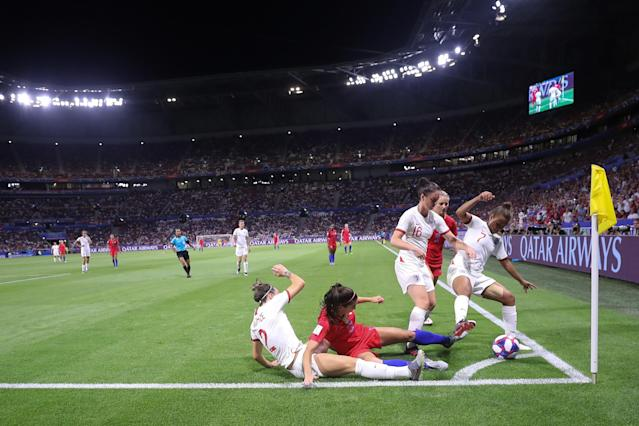 Alex Morgan of the USA is challenged by Lucy Bronze, Jade Moore and Nikita Parris of England during the 2019 FIFA Women's World Cup France Semi Final match between England and USA at Stade de Lyon on July 02, 2019 in Lyon, France. (Photo by Alex Grimm/Getty Images)