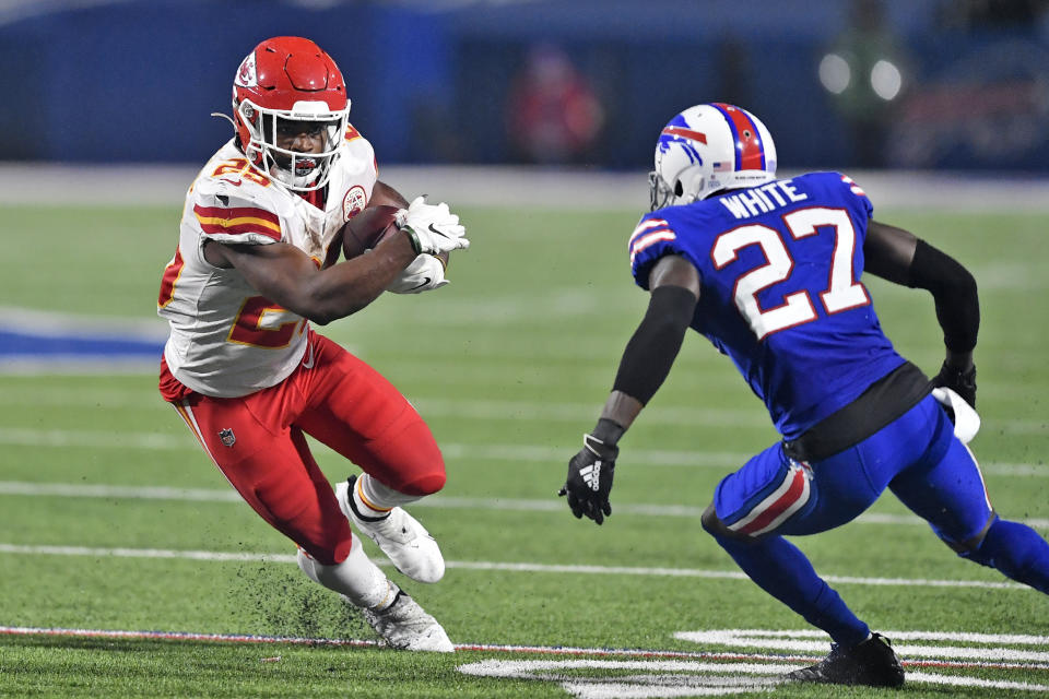 Clyde Edwards-Helaire runs with the ball as Bills cornerback Tre'Davious White defends.