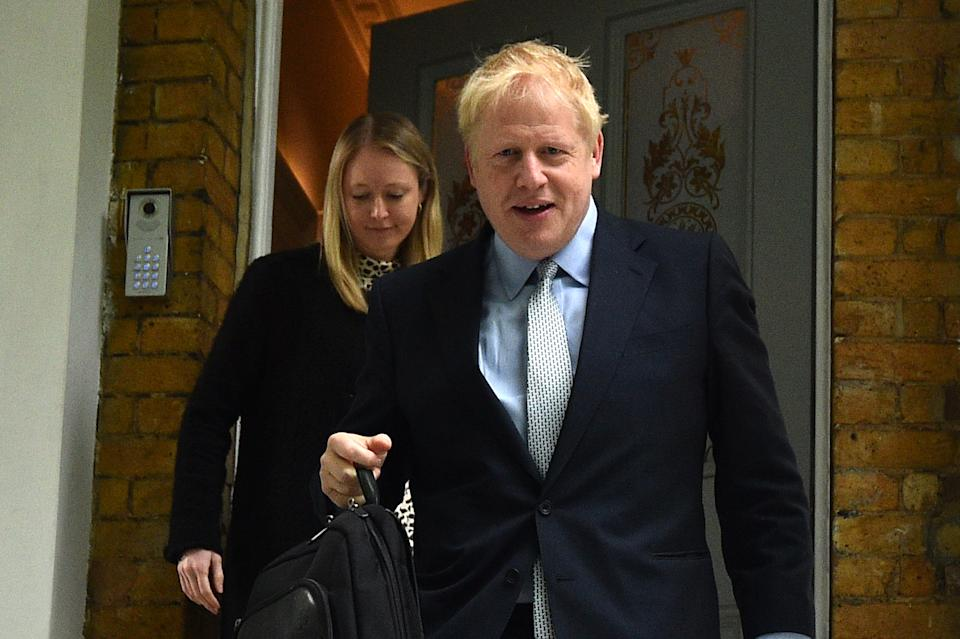 TOPSHOT - Conservative MP Boris Johnson leaves his home in London on June 13, 2019. - The 10 candidates running to replace Britain's outgoing Prime Minister Theresa May face the first round of voting on Thursday -- when at least one will get the chop. (Photo by Glyn KIRK / AFP)        (Photo credit should read GLYN KIRK/AFP/Getty Images)