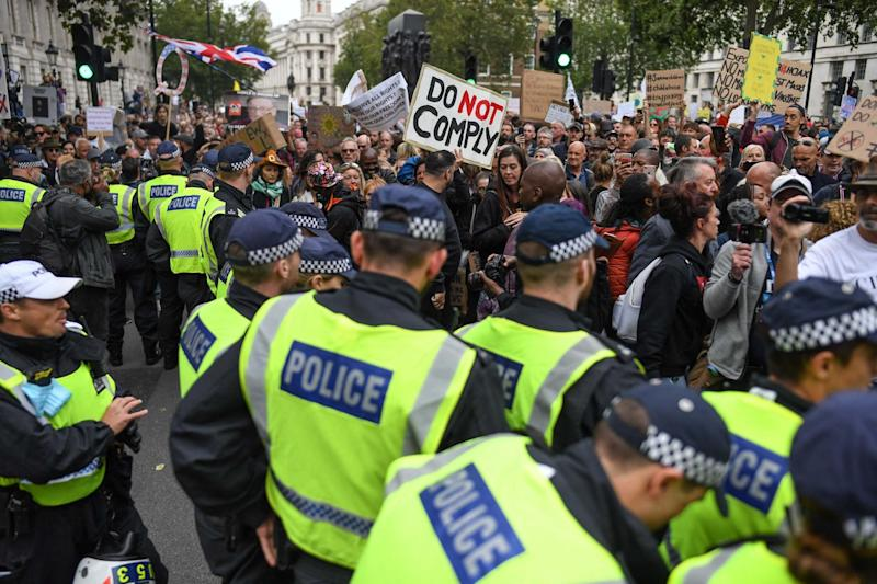 Police confronted the hoards of anti-mask demonstrators (Getty Images)