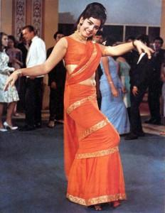 <p>When we think of old Bollywood, this orange saree wrapped against Mumtaz's body is sure to cross our minds. We have never been to a Retro Bollywood party that didn't have one over enthusiastic guest dressed as Mumtaz from Bhrahmachari. This costume will be mentioned in golden ink in the books of Bollywood fashion. </p>