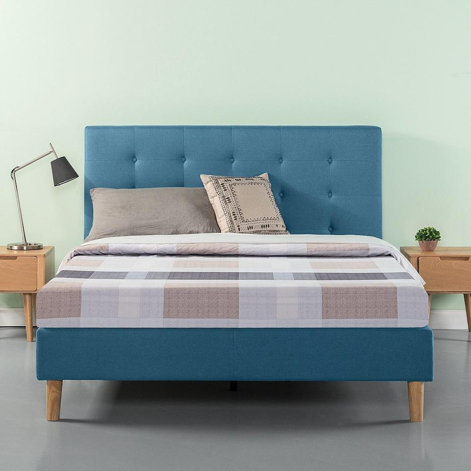 "<p>Add some color to your bedroom with this <a href=""https://www.popsugar.com/buy/Zinus-Ibidun-Upholstered-Tufted-Platform-Bed-481135?p_name=Zinus%20Ibidun%20Upholstered%20Tufted%20Platform%20Bed&retailer=walmart.com&pid=481135&price=190&evar1=casa%3Aus&evar9=45867877&evar98=https%3A%2F%2Fwww.popsugar.com%2Fhome%2Fphoto-gallery%2F45867877%2Fimage%2F46654255%2FZinus-Ibidun-Upholstered-Tufted-Platform-Bed&list1=shopping%2Chome%20decor%2Cfurniture%2Chome%20shopping&prop13=api&pdata=1"" rel=""nofollow"" data-shoppable-link=""1"" target=""_blank"" class=""ga-track"" data-ga-category=""Related"" data-ga-label=""https://www.walmart.com/ip/Zinus-Ibidun-Blue-Upholstered-Tufted-Platform-Bed-Multiple-Sizes/380681223"" data-ga-action=""In-Line Links"">Zinus Ibidun Upholstered Tufted Platform Bed</a> ($190).</p>"