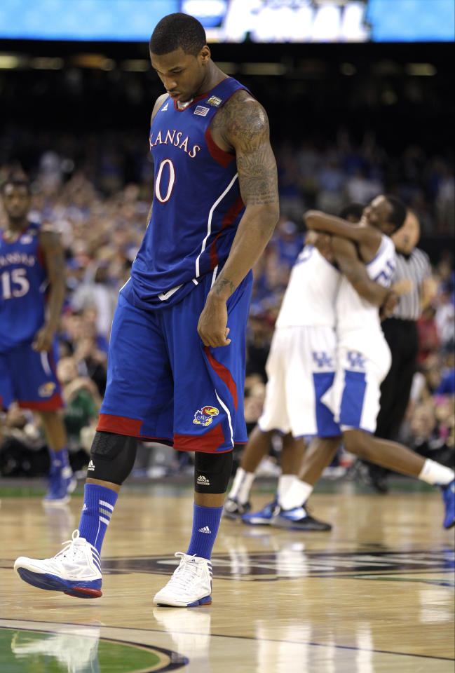 Kansas forward Thomas Robinson (0) reacts after the NCAA Final Four tournament college basketball championship game Monday, April 2, 2012, in New Orleans. Kentucky won 67-59. (AP Photo/Mark Humphrey)