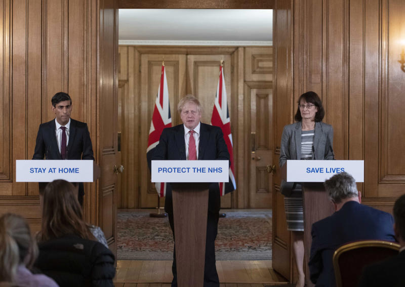 Britain's Prime Minister Boris Johnson, centre, Chancellor Rishi Sunak, left and Deputy Chief Medical officer for England Jenny Harries take part in a Coronavirus press conference, in Downing Street, London, Friday, March 20, 2020. (Julian Simmonds/Pool Photo via AP)