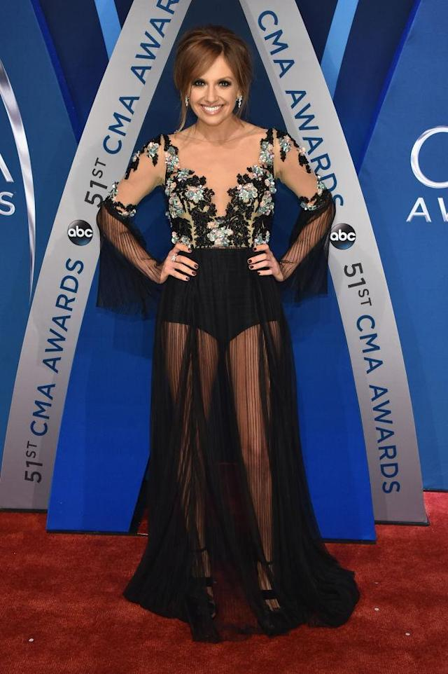 <p>The singer kept it sheer and sophisticated with a floral bodice dress. (Photo: Getty Images) </p>