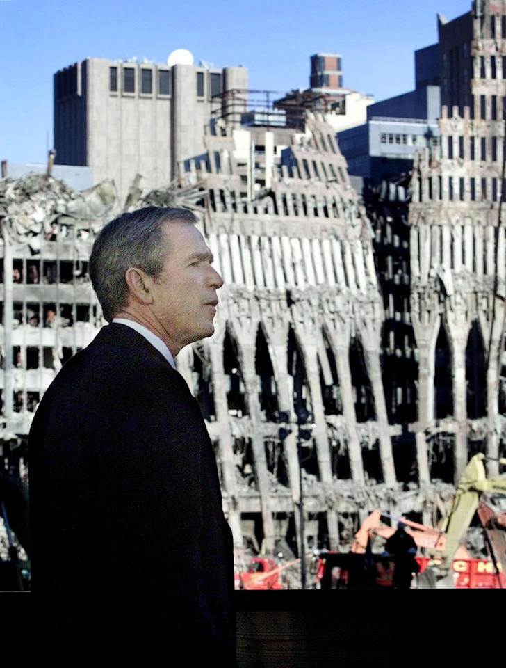 U.S. President George W. Bush visits Ground Zero at the World Trade Center for a memorial service in New York, November 11, 2001. (REUTERS/Larry Downing LSD/ME)