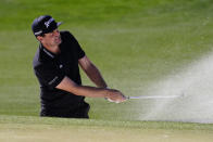 Keegan Bradley hits out of the bunker on the 15th hole during the final round of a PGA golf tournament on Sunday, Feb. 7, 2021, in Scottsdale, Ariz. (AP Photo/Rick Scuteri)