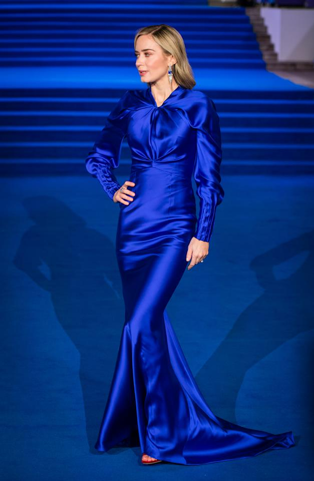 <p>The 35-year-old matched the blue carpet in a satin gown by Schiaparelli. <em>[Photo: Getty]</em> </p>