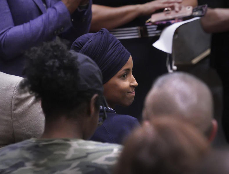 U.S. Rep. Ilhan Omar reacts after being introduced in the Minneapolis City Council Chambers before Minneapolis Mayor Jacob Frey's budget address Thursday, Aug. 15, 2019, in Minneapolis. (Brian Peterson/Star Tribune via AP)