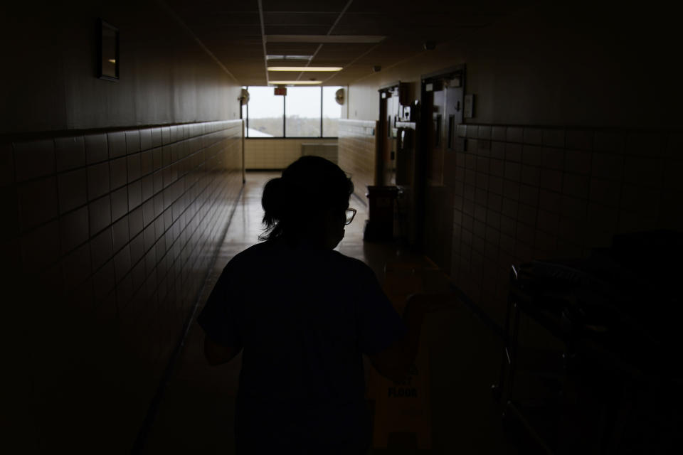 Jana Semere, Chief nursing officer at Leonard J. Chabert Medical Center, walks down a hallway at the hospital in the recently reopened emergency room in the aftermath of Hurricane Ida, Friday, Sept. 3, 2021, in Houma, La. The hospital evacuated patients and had to close due to the hurricane. (AP Photo/John Locher)