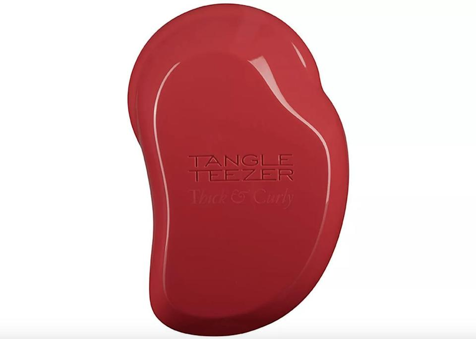 <p>The flexible teeth on the <span>Tangleteezer Thick and Curly Detangling Hairbrush</span> ($12) will gently detangle even the most unruly of curls.</p>