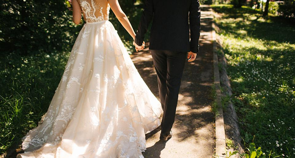 Pictured is a stock image of a couple on their wedding day.
