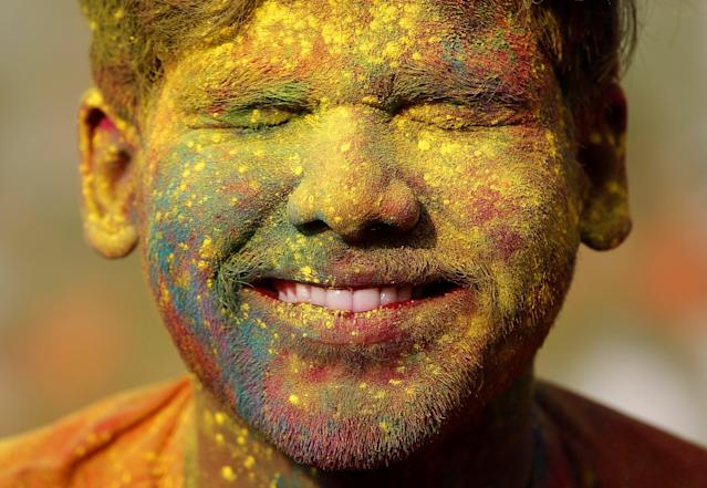 <p>A student of Rabindra Bharati University, with his face smeared in coloured powder, reacts as his fellow student throws coloured powder on his face during Holi celebrations inside the university campus in Kolkata, India, Feb. 26, 2018. (Photo: Rupak De Chowdhuri/Reuters) </p>