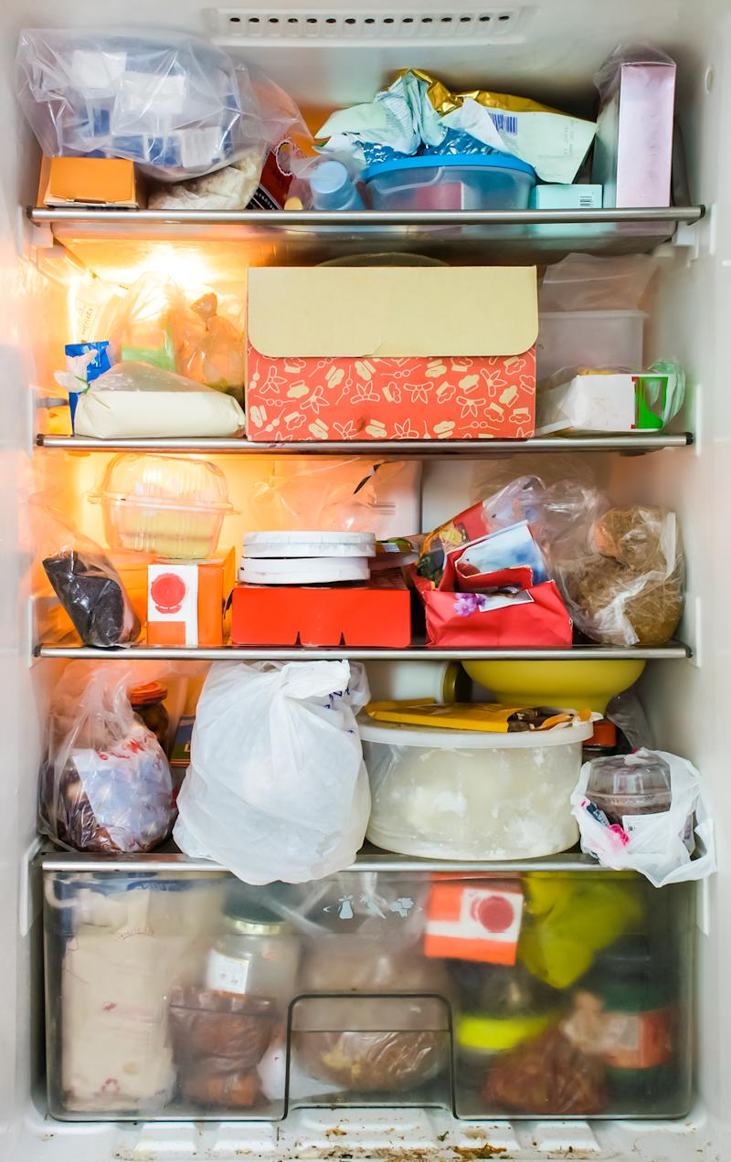 Pictured is a fridge fully stocked with old food.