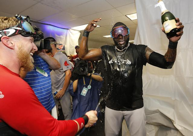Boston Red Sox 's David Ortiz, right, is sprayed with champagne after the team defeated the Tampa Bay Rays in Game 4 of an American League baseball division series, Wednesday, Oct. 9, 2013, in St. Petersburg, Fla. The Boston Red Sox's defeated the Tampa Bay Rays 3-1 to move on to the American League Championship Series. (AP Photo/Mike Carlson)