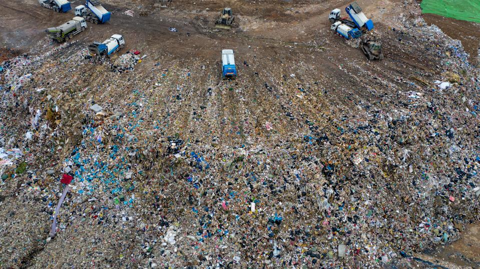 Chinese workers sort out and bury kitchen waste at the Jiangcungou Landfill, which is the China's largest refuse landfill, in Xi'an city, northwest China's Shaanxi province, 21 August 2019. China's largest refuse landfill was set to close in October 2019 as it was almost saturated in Xi'an city, northeast China's Shaanxi province. The landfill was put into use in June 1994. (Photo by Tian ye - Imaginechina/Sipa USA)