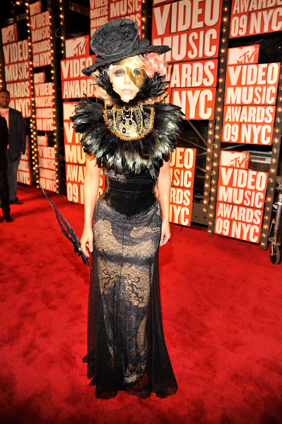 Gaga wears a dress by Jean Paul Gaultier on the red carpet at the 2009 MTV VMAs.