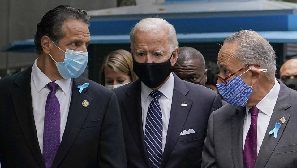FILE - This photo from Friday, Sept. 11, 2020, shows President Joe Biden, center, as a presidential candidate walking with New York Gov. Andrew Cuomo, left, and Sen. Chuck Schumer of N.Y., after arriving for a ceremony marking the 19th anniversary of the Sept. 11 terrorist attacks. Senate Majority Leader Schumer declined to comment on Cuomo's crisis on Friday, as he stood alongside Biden in a Rose Garden ceremony celebrating the passage of the Democrat-backed $1.9 trillion pandemic relief bill. (AP Photo/Patrick Semansky, File)