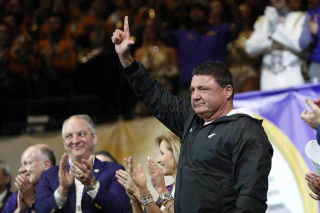 LSU head coach Ed Orgeron acknowledges the crowd during a celebration of their NCAA college football championship, Saturday, Jan. 18, 2020, on the LSU campus in Baton Rouge, La. (AP Photo/Gerald Herbert)