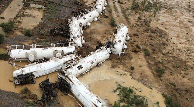 Emergency crews are continuing the clean-up operation after a freight train derailment in Queensland. Photo: AAP