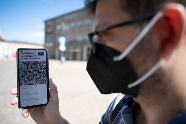 TURIN, ITALY - JUNE 30: A man shows Italy's Covid-19 Green Pass for post-vaccine travel on a smartphone on June 30, 2021 in Turin, Italy. The digital health certificate, or Green Pass, was officially launched by Italian Prime Minister Draghi, allowing people to access certain events and facilities in Italy as well as travel domestically and abroad. (Photo by Stefano Guidi/Getty Images) (Photo: Stefano Guidi via Getty Images)