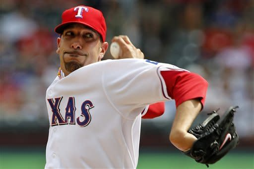 Texas Rangers' Mike Adams (37) delivers to the Seattle Mariners in the ninth inning of a baseball game, Thursday, April 12, 2012, in Arlington, Texas. The Rangers won 5-3. (AP Photo/Tony Gutierrez)