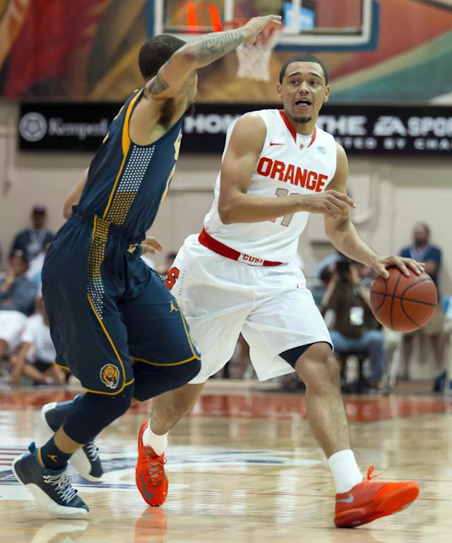 California guard Justin Cobbs, left, challenges Syracuse guard Tyler Ennis (11) as he brings the bal up court in the first half of an NCAA college basketball game at the Maui Invitational on Tuesday, Nov. 26, 2013, in Lahaina, Hawaii. (AP Photo/Eugene Tanner)