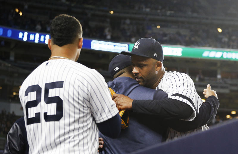 Sep 18, 2019; Bronx, NY, USA; New York Yankees starting pitcher CC Sabathia (52) is hugged by a teammate after being taken out of the game against the Los Angeles Angels during the third inning at Yankee Stadium. Mandatory Credit: Andy Marlin-USA TODAY Sports