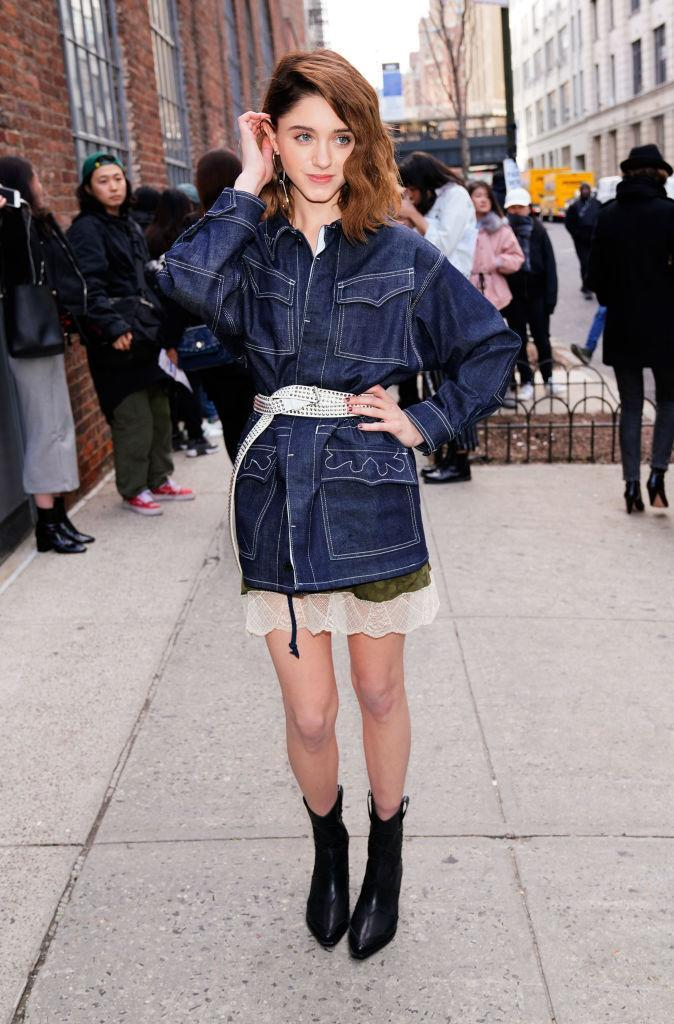 <p>'Stranger Things' star Natalia Dyer gave us serious outfit envy at the AW18 Calvin Klein show during New York Fashion Week. The actress layered a denim shirt over a lace dress and finished the look with this season's most coveted trend, the cowboy boot. <em>[Photo: Getty]</em> </p>
