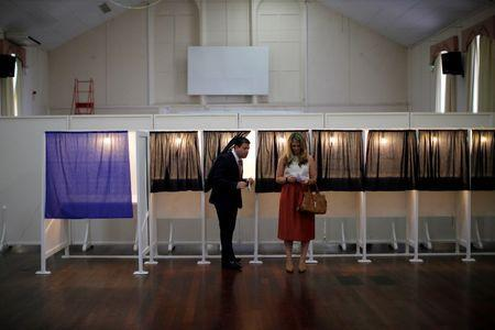 Gibraltar's Chief Minister Fabian Picardo (L) and his wife Justine Olivero prepare their ballots before casting their votes at a polling station in the British overseas territory of Gibraltar, historically claimed by Spain. REUTERS/Jon Nazca