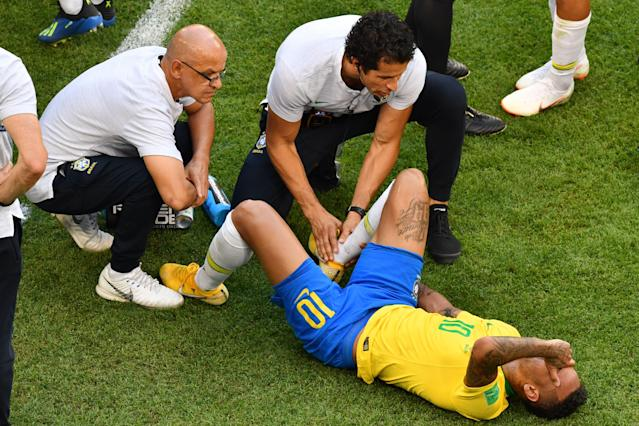 Brazil star Neymar received treatment after Miguel Layun stood on his ankle on the sideline during Monday's 2018 World Cup Round of 16 game. (Getty)