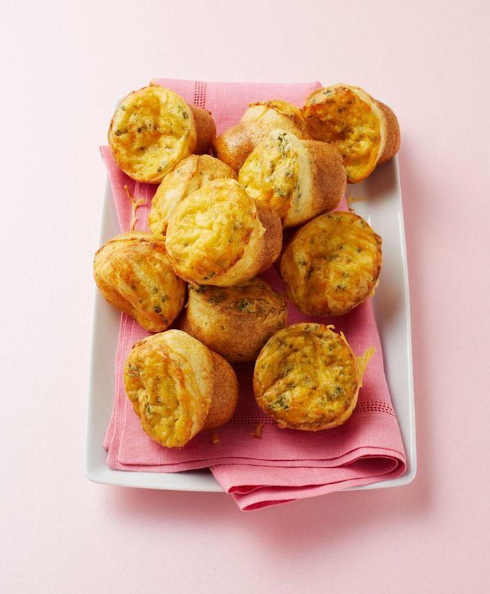 """<p>Popovers may not be your typical party food, but these cheesy, fluffy bites will change that. <br></p><p><em><a href=""""https://www.womansday.com/food-recipes/food-drinks/recipes/a12563/mini-cheese-popovers-recipe-wdy0114/"""" rel=""""nofollow noopener"""" target=""""_blank"""" data-ylk=""""slk:Get the Mini Cheese Popovers recipe."""" class=""""link rapid-noclick-resp"""">Get the Mini Cheese Popovers recipe.</a></em></p>"""