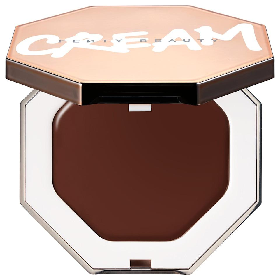 """<p><strong>Fenty Beauty by Rihanna</strong></p><p>sephora.com</p><p><strong>$32.00</strong></p><p><a href=""""https://go.redirectingat.com?id=74968X1596630&url=https%3A%2F%2Fwww.sephora.com%2Fproduct%2Ffenty-beauty-rihanna-cheeks-out-freestyle-cream-bronzer-P31870457%3FskuId%3D2352896&sref=https%3A%2F%2Fwww.goodhousekeeping.com%2Fbeauty-products%2Fg36020083%2Fbest-bronzer-for-dark-skin%2F"""" rel=""""nofollow noopener"""" target=""""_blank"""" data-ylk=""""slk:Shop Now"""" class=""""link rapid-noclick-resp"""">Shop Now</a></p><p>Rihanna to the rescue: This Fenty Beauty cream bronzer has <strong>a texture that melts into your skin for a believable finish</strong>. It's light and buildable so you choose whether you want a sheer or deeper glow. It can be hard to find a cream bronzer for very deep skin tones, and Toffee Tease is the holy grail, providing a nice contour. </p>"""