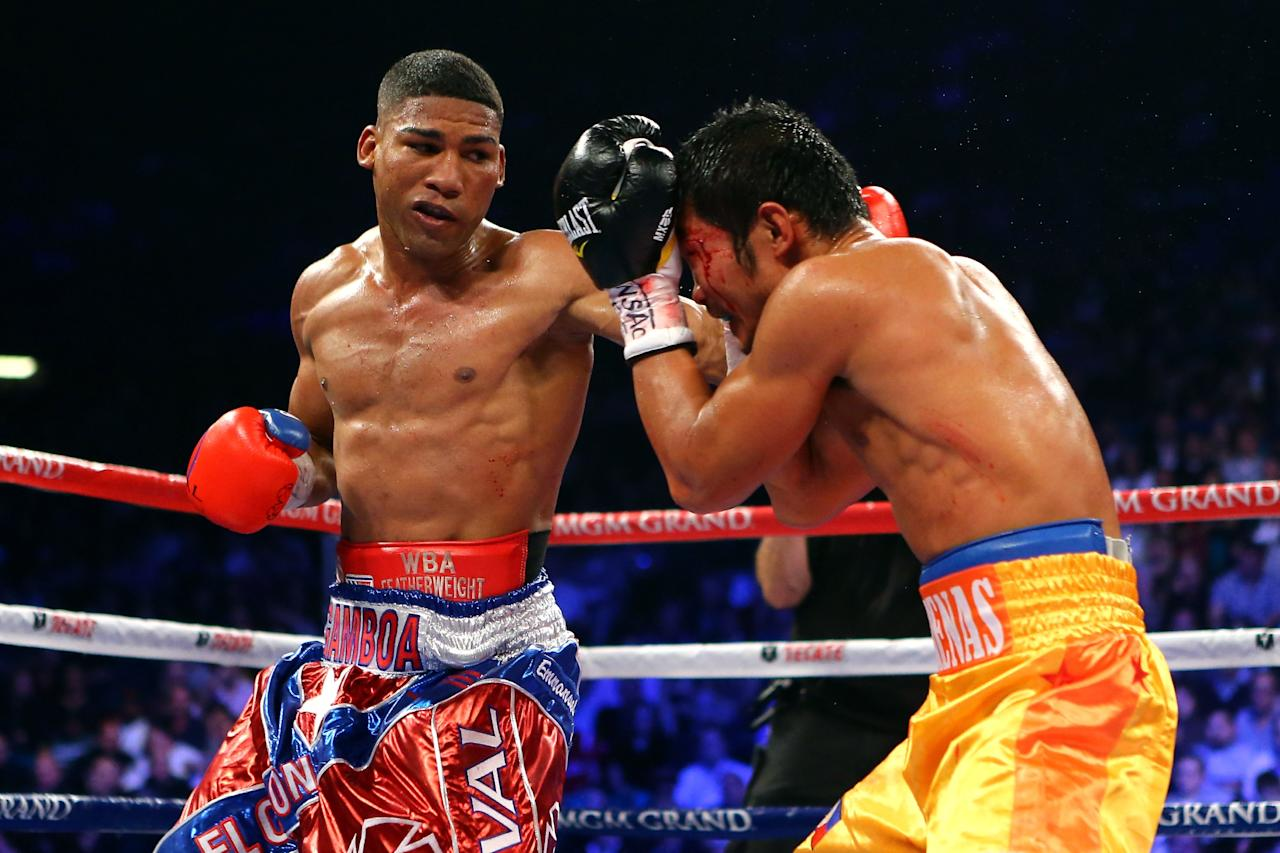 LAS VEGAS, NV - DECEMBER 08:  (L-R) Yuriorkis Gamboa throws a left at Michael Farenas during their super featherweight bout at the MGM Grand Garden Arena on December 8, 2012 in Las Vegas, Nevada.  (Photo by Al Bello/Getty Images)