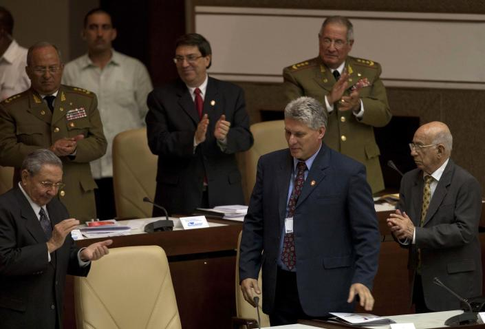 Newly appointed Cuba's Vice-President Miguel Diaz-Canel, bottom center, and Cuba's President Raul Castro, bottom left, participate in the closure session of the National Assembly in Havana, Cuba, Sunday, Feb. 24, 2012. Raul Castro accepted a new five-year term that will be, he said, his last as Cuba's president and tapped rising star Diaz-Canel, 52, as vice-president and first in the line of succession, replacing the 81-year-old Jose Ramon Machado Ventura, bottom right. (AP Photo/Ramon Espinosa)