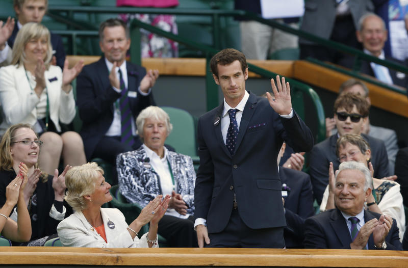 Britain's Andy Murray of Britain waves as he takes his seat on Centre Court at the All England Lawn Tennis Championships in Wimbledon, London, Saturday, June 29, 2013. (AP Photo/Sang Tan)
